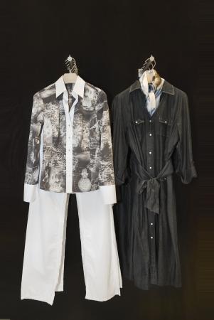 Ladies retro clothing on hangers at store