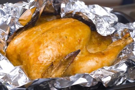 cooking juicy golden chicken foil Stock Photo - 16593880