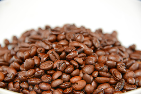 zoomed: zoomed coffee beans over white Stock Photo