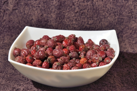 zoomed: many red dried dog-rose hips