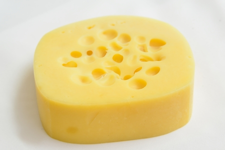 glossy cheese with holes over white