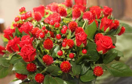 modern bouquet of red  roses and red berries