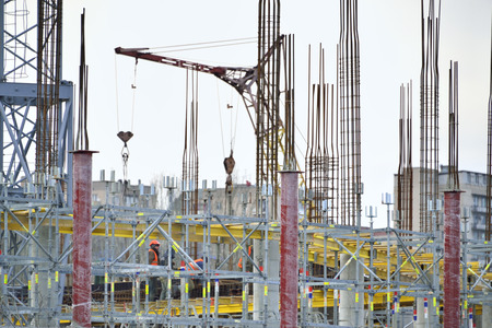 armature: workers build  with crane (armature and fittings) Editorial