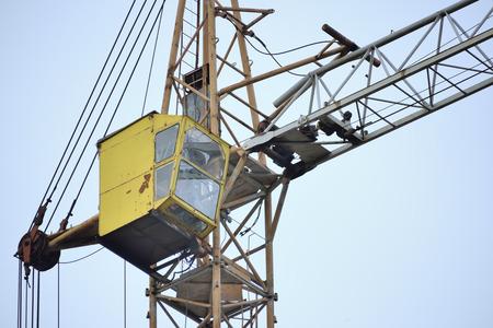 yellow building crane over blue sky