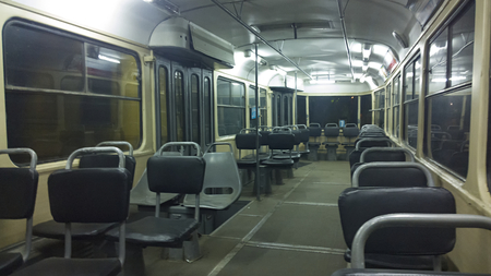 tramcar: inside old empty tram at night Stock Photo