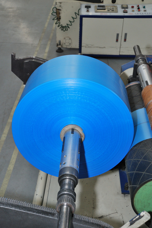 wounding roll of blue polyethylene in fabric