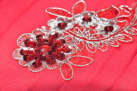 applique: red material with flowers applique