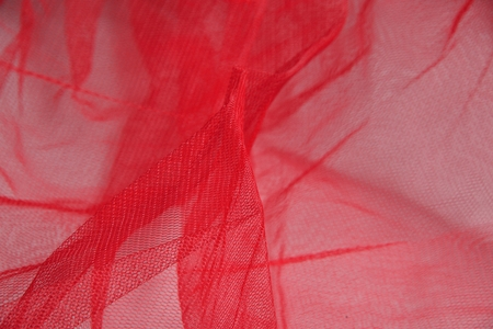 organza: zoomed red organza material with folds Stock Photo