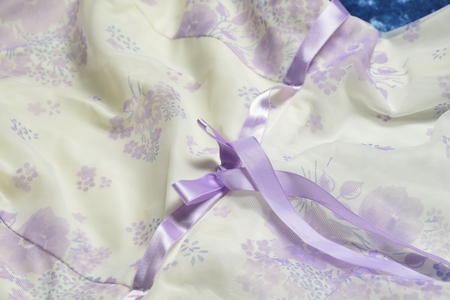 purple ribbon: white tulle with purple  ribbon and bow