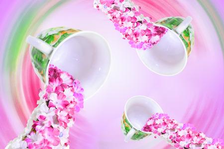 slop: flowers herbal tea in pink vortex of cups