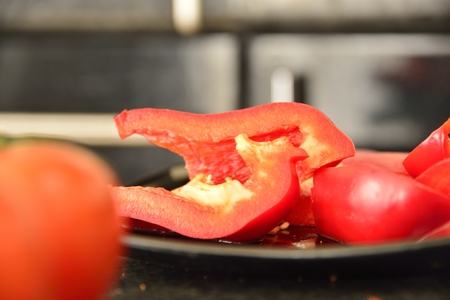 Preparation of salad from tomatoes and peppers