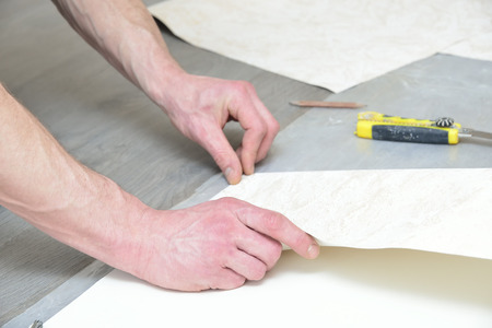 etched: preparation for glueing wallpaper (measurement and marking)
