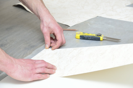 preparation for glueing wallpaper (measurement and marking)