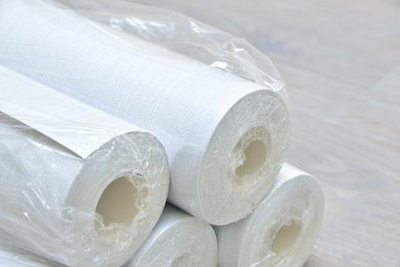 many gray wallpaper rolls on floor Reklamní fotografie