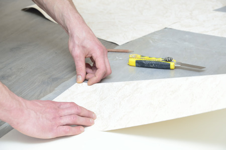 profile measurement: preparation for cutting and glueing wallpaper (measurement and marking) Stock Photo