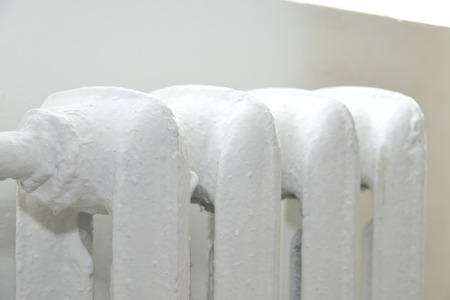 convection: white central heating system radiator in room