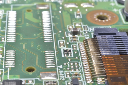 information processing system: pins and wires on microcontroller (computer background)