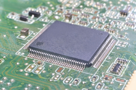 planar: chip on motherboard (mainboard) with controllers, ports and wires Stock Photo