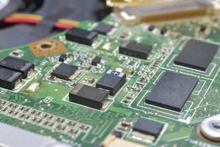 information processing system: chip on motherboard (mainboard) with controllers, ports and wires Stock Photo