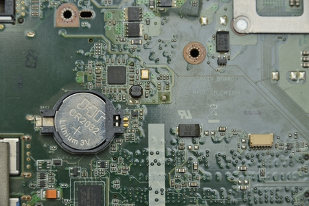 information processing system: battery on  motherboard (mainboard) with chips, sockets, controllers