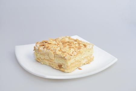 custard slice: sweet cream tompouce cake on white plate