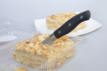 custard slice: cutting cake in transparent box (blister) from supermarket