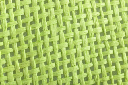 braided: macro green braided canvas background