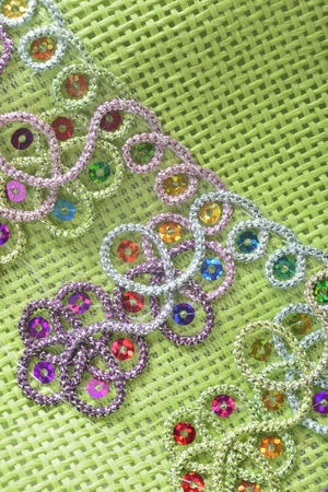 applique flower: green cutout on woven fabric background