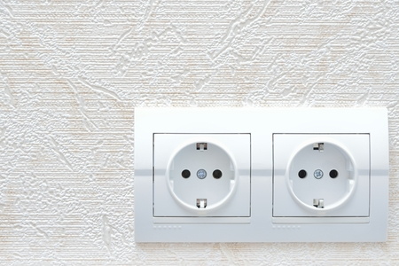 sockets: two white new electrical sockets (rosette) on wall Stock Photo