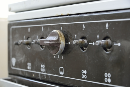 old gas stove: old gas stove with one handle Stock Photo