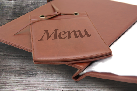 brown leather menu in a restaurant or cafe on wooden background