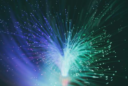 information from optic fiber makes luminous vortex ( blur background )