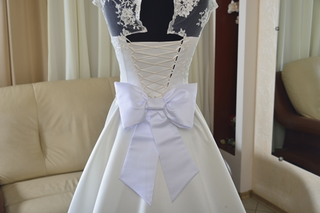 ivory wedding dress with white bow and corset (choice of dress for the bride in the store )