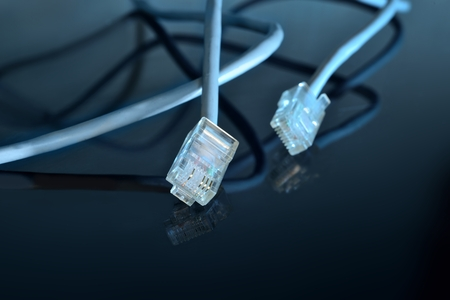 ethernet cable: macro ethernet cable on black mirror surface