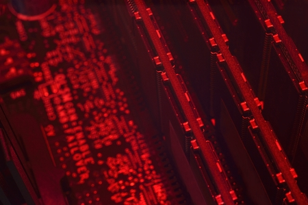 microcircuit: dark abstract red microcircuit with RAM background Stock Photo