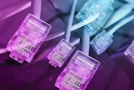 purple macro ethernet plug with cable on black mirror surface abstract background Reklamní fotografie
