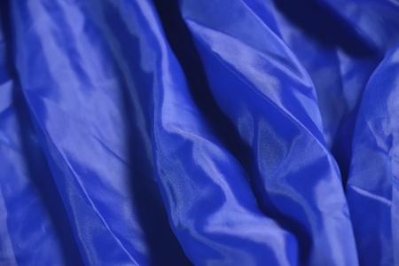 deep folds on blue satin fabric abstract background Reklamní fotografie