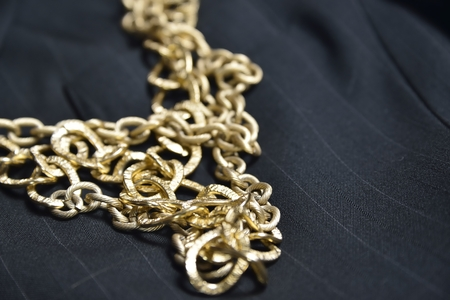 gold chain: gold chain (jewelry) background over black Stock Photo