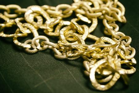 gold chain (jewelry) background over black Reklamní fotografie