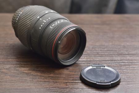 camera lens on wooden background