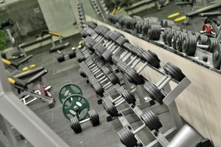 fitness center: dumbbells in the gym (sports training fitness center)