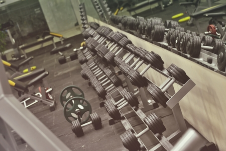 dumbbells in the gym (sports training fitness center)