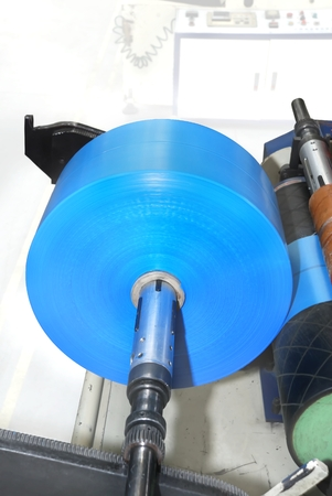 winding into a roll of polyethylene  (machine for the production of polyethylene)