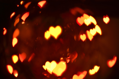 love abstract blur background (hearts particles flying in darkness)