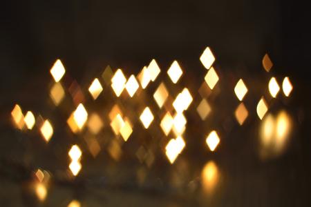 luminous: luminous rhombus flying in darkness abstract blur background Stock Photo