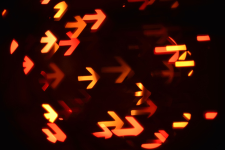 denote: arrows shows way of direction to business goal (abstract blur background)