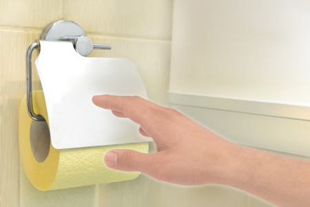 fecal: Hand in toilet reaches for toilet paper (facial tissues)