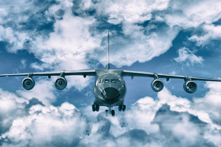 cargo or passenger plane fly in air with clouds (overcast) Reklamní fotografie