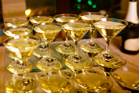 conical cocktail glasses with white wine