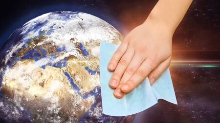 hand with wet wipe cleaning planet on quarantine from virus. Disinfection of the world. Hygiene rules on the quarantine